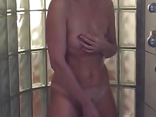 Wife has fun under shower
