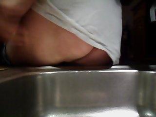 peeing in kitchen