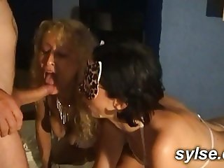2 MILFs sharing bukkake in public cinema