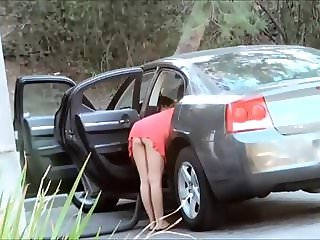 Unknown man lowers the thong to a woman in the street