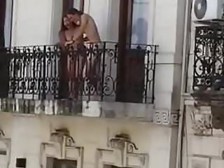 couple fucking in the balcony of main road hotel